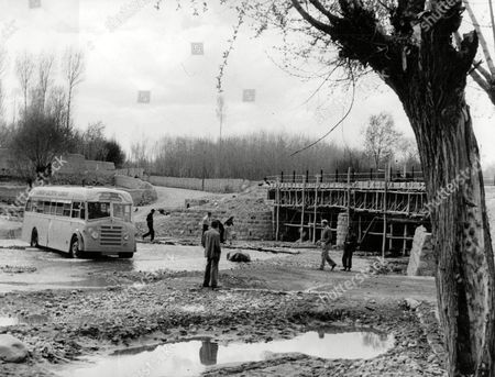 Editorial photo of London To Calcutta Bus Trip 1957 (london To India By Bus) Here In Iran The Coach Full Of 20 British Facing A Washed Out Bridge Under Repair But Still In Passable The Only Way Across Is To Drive Through The Stream