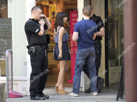Stock Picture of Roxanne Pallett and Neil Toon report the theft of a mobile phone