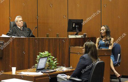 Judge Michael E Pastor listens as Nicole Alvarez gives evidence