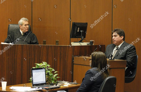 Judge Michael E. Pastor listens as Tim Lopez gives evidence