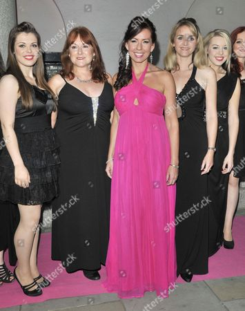 Stock Image of Justine Balmer (in pink) and guests
