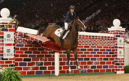 Tina Fletcher (GBR) in The Tagg Puissance jumping 7 ft 3 ins