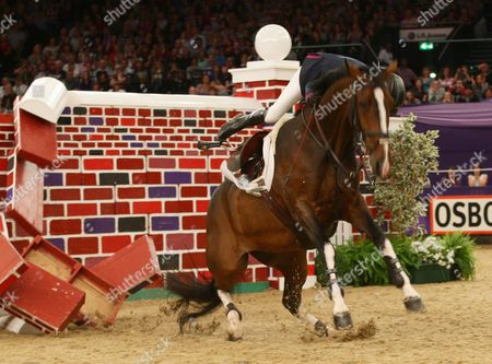 Tina Fletcher (GBR) falling off her horse in The Tagg Puissance jumping 7 ft 3 ins