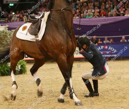 Stock Picture of Tina Fletcher (GBR) falling off her horse in The Tagg Puissance jumping 7 ft 3 ins