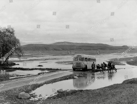 London To Calcutta Bus Trip 1957 (london To India By Bus) The Coach Full Of 20 British During Their Trip Pushing The Bus Near Tabriz In Persia In Flood Waters
