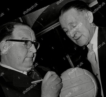 Journalist Roy Peskett Signing The World's Most Expensive Football Which Is Signed By The Likes Of Jayne Mansfield The Platters Dave Charnley And Henry Cooper. The Football Has Been Insured For A1 000 By Charles Coward (right) Who Wants To Sell It For A500.