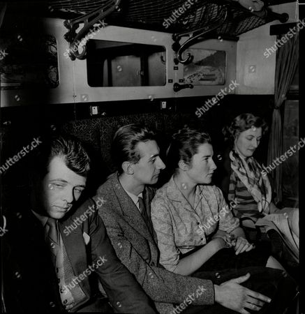 Murder Witnesses Bill Humphreys Margaret Brown Her Fiance Stuart Campbell And Mrs Evelyn Peake On A Train From Birmingham To London. They Are To Go Through Thousands Of Photographs In The 'rogues Gallery' At Scotland Yard In An Effort To Identify The Maniac Who Beheaded 29-year-old Stephanie Baird In A Birmingham Y.m.c.a. Hostel Eight Years Ago.