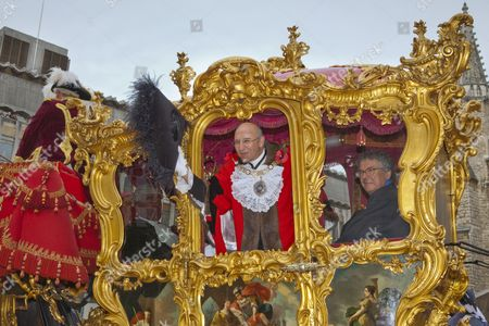 Alderman Michael Bear, the Lord Mayor of London wearing traditional costume waving from the golden state coach, Lord Mayor's Show in the City of London, England, United Kingdom, Europe