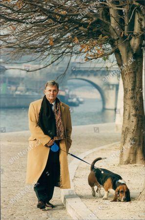 Author Edmund White In Paris With His Pet Dog