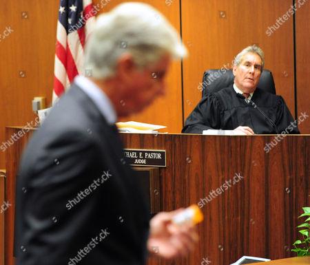 Judge Michael E Pastor looks on as defense attorney J. Michael Flanagan makes statements