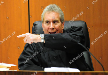 Judge Michael E Pastor instructs the defense counsel to return to his position in the courtroom
