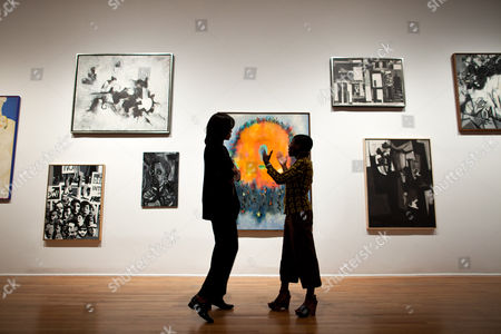 First Lady Michelle Obama talks with Director and Chief Curator Thelma Golden during a tour of the Studio Museum in Harlem, in New York, New York