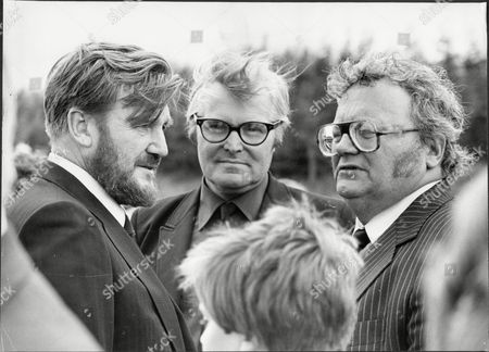 Stock Photo of (l To R) Donald Houston Leonard White Harry Secombe At The Funeral Service Of Stanley Baker.
