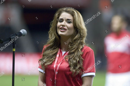 Miss Wales Courtenay Hamilton singing at the start of the game.