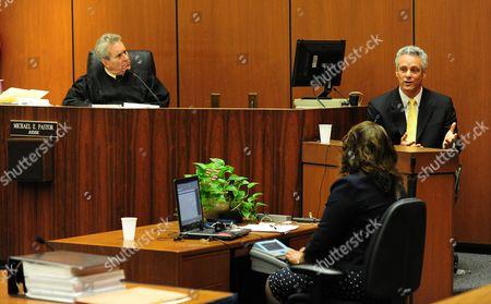 Judge Michael E. Pastor (L) listens to Dr. Alon Steinberg