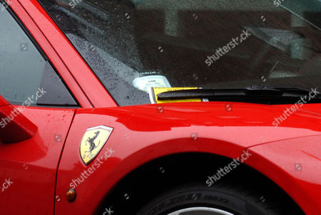 Alexander Doni's Ferrari with a parking ticket