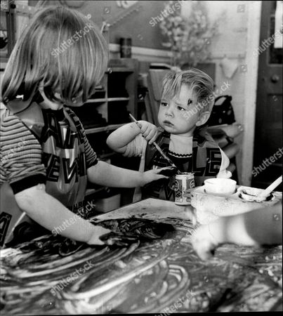 Stock Image of Children Painting At The Mother And Toddler Group St Stephen's Primary School Yiewsley. Two-year-old Suzanne Roberts With Another Child.