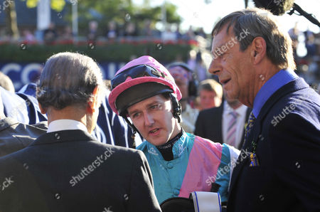 After winning on Frankel, Tom Queally talks to owner Prince Khalid Abdullah and (R) trainer Henry Cecil after The Queen Elizabeth II stakes