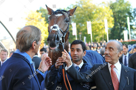 After winning with Frankel, (R) owner Prince Khalid Abdullah and (L) trainer Henry Cecil after The Queen Elizabeth II stakes