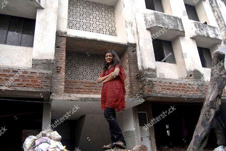 Rubina Ali outside of her new home