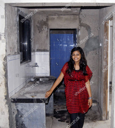 Stock Picture of Rubina Ali inside her new home