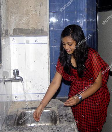 Stock Image of Rubina Ali inside her new home