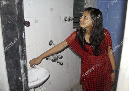 Stock Photo of Rubina Ali inside her new home