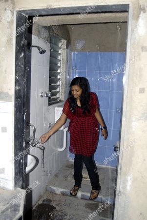 Rubina Ali inside her new home