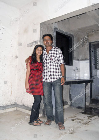 Rubina Ali inside her new home with her father