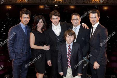 Joe Jonas, Denise Jonas, Nick Jonas (Marius), Frankie Jonas, Kevin Jonas Sr and Kevin Jonas backstage after the curtain call