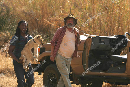 Atandwa Kani as Thabo and Deon Stewardson as Du Plessis.