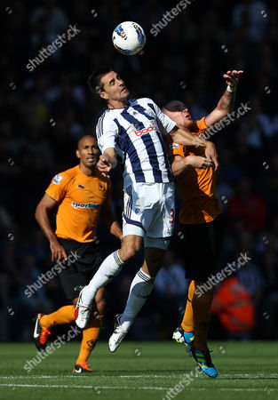 Paul Scharner of West Bromwich Albion in action with Jamie O'Hara of Wolverhampton Wanderers