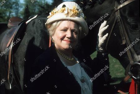 Hermione Baddeley as Mrs Beddows