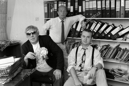 Peter Cook, Dave Cash and Ian Hislop at the Private Eye office, London, Britain