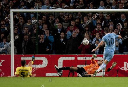 Carlos Marchena scores an own goal past Goalkeeper Diego Lopez of Villarreal as Edin Dzeko of Manchester CIty closes in, 1-1