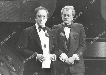 The Evening News British Film Awards: Peter Sellers Collects Producer Blake Edwards' Award For The Best Comedy From Joseph Cotten.