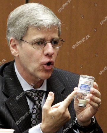Anaesthesiology expert Dr. Steven Shafer holds a Propofol bottle
