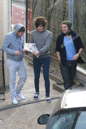 Frankie Cocozza with the Daily Star which features him on the front page, showing Andrew Merry and Charlie Healy from The Risk.