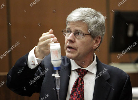 Anesthesiology expert Dr. Steven Shafer holds a bottle of propofol