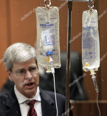 Dr. Steven Shafer with a bottle of propofol and a bag of saline solution