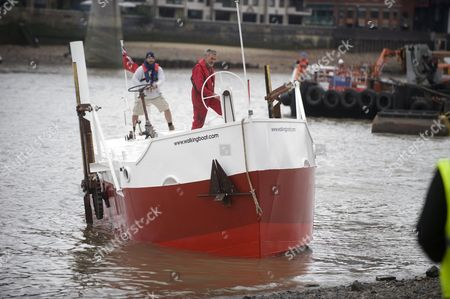 Sculptor Andrew Baldwin On Board His Work 'the Boat That Walked' A Kinetic 40ft Boat With Legs. However On Arriving At The Thames Foreshore By Tate Modern He Could Not Get The Boat Out Of The Water. Picture By Glenn Copus