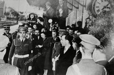 Prince Jean Of Luxemburg Awaits The Royal Train Bringing Princess Josephine Charlotte Of Belgium For Their Wedding. People Crowd The Station Platform At Kleinbettingen To Greet Her.