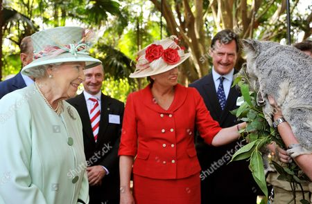Queen Elizabeth II and Queensland Premier Anna Bligh shown a pair of koala bears on the banks of the Brisbane River