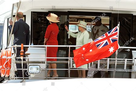 Queen Elizabeth II, Prince Philip and Queensland Premier Anna Bligh journey down the river on the motor cruiser Pure Adrenalin, on the Brisbane river