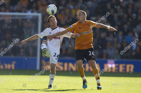 Swansea City midfielder Joe Allen and Jamie O'Hara of Wolverhampton Wanderers in action