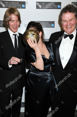 Stock Image of Rory Stuart Kinnear (co-writer of the screenplay), Lynne Ramsay (winner: Best Film award - for We Need to Talk About Kevin) with John Madden (R)