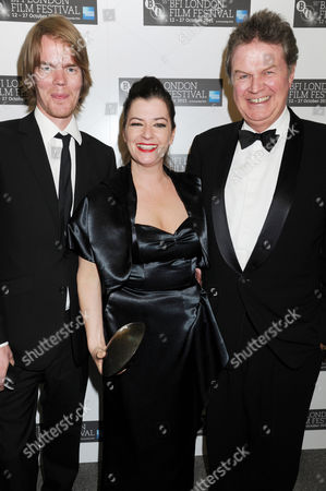 Stock Photo of Rory Stuart Kinnear (co-writer of the screenplay), Lynne Ramsay (winner: Best Film award - for We Need to Talk About Kevin) with John Madden (R)