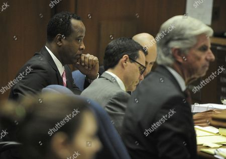 Dr. Conrad Murray with defence attorneys Edward Chernoff and J. Michael Flanagan