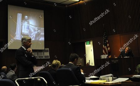 Slide projection of a propofol bottle is shown as defence attorney J. Michael Flanagan questions a witness