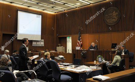 Deputy District Attorney David Walgren cross-examines Dr. Paul White